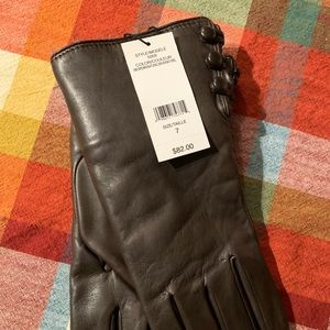 Genuine leather gloves with real fur lining. BNWT